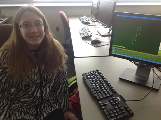 Miriam Ureel shows off her drawing made with the Logo programming language.